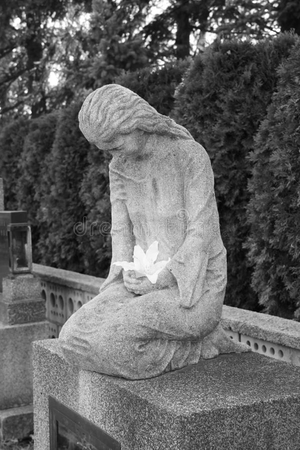 Statue of mourning woman stock photography