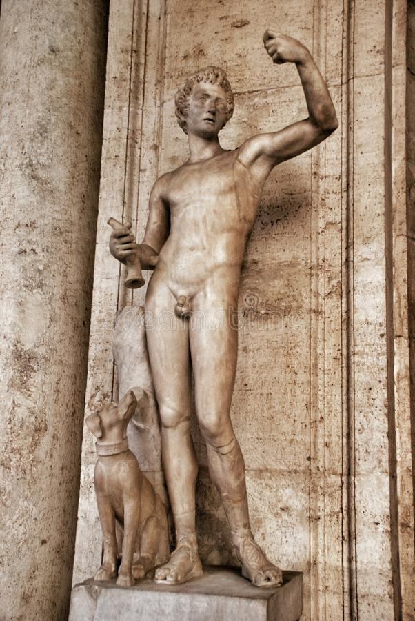 Statue boy with dog in Museum Capitoline, Rome Italy royalty free stock photo