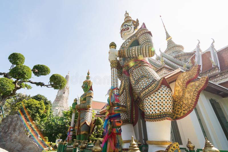 Statue of the mythical Guard at the entrance of Ordination hall at Wat Arun in Bangkok, Thailand. Southeast asia oriental travel old traditional tourism grand stock image