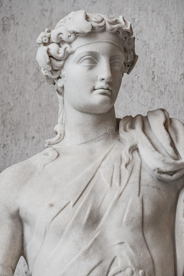 Statue of naked handsome Apollo with a raising hand, Rome, Ital royalty free stock photography