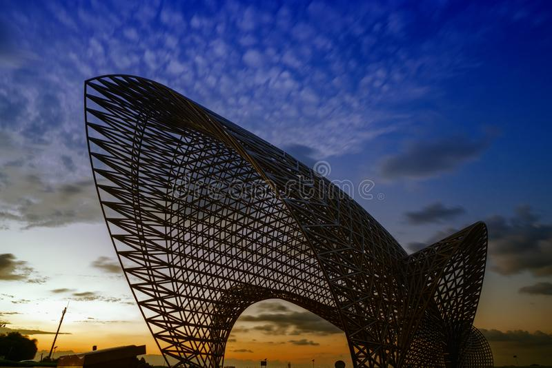 Statue near the East Sea of China. Luchaogang Pudong Shanghai. In nightfall, a stainless steel statue stock image