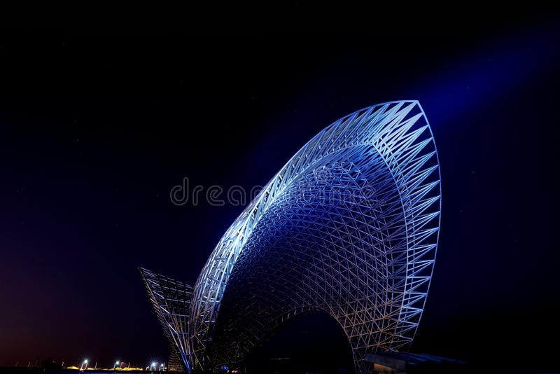 Statue near the East Sea of China. Luchaogang Pudong Shanghai. In nightfall, a stainless steel statue royalty free stock photography