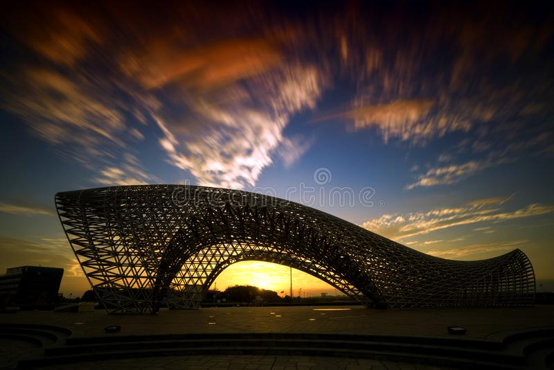 Statue near the East Sea of China. Luchaogang Pudong Shanghai. In nightfall, a stainless steel statue stock photos