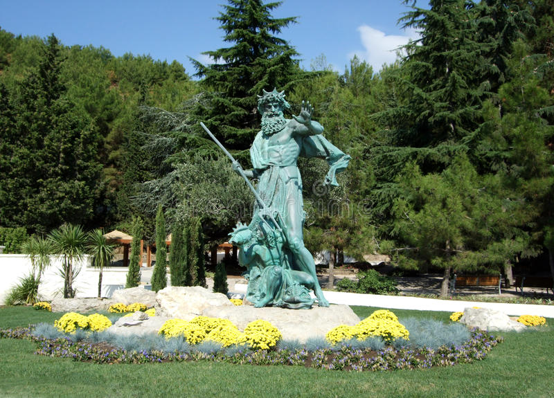 Statue Neptune holds a trident and a girl is a seashell in Aivazovsky park. Crimea stock image