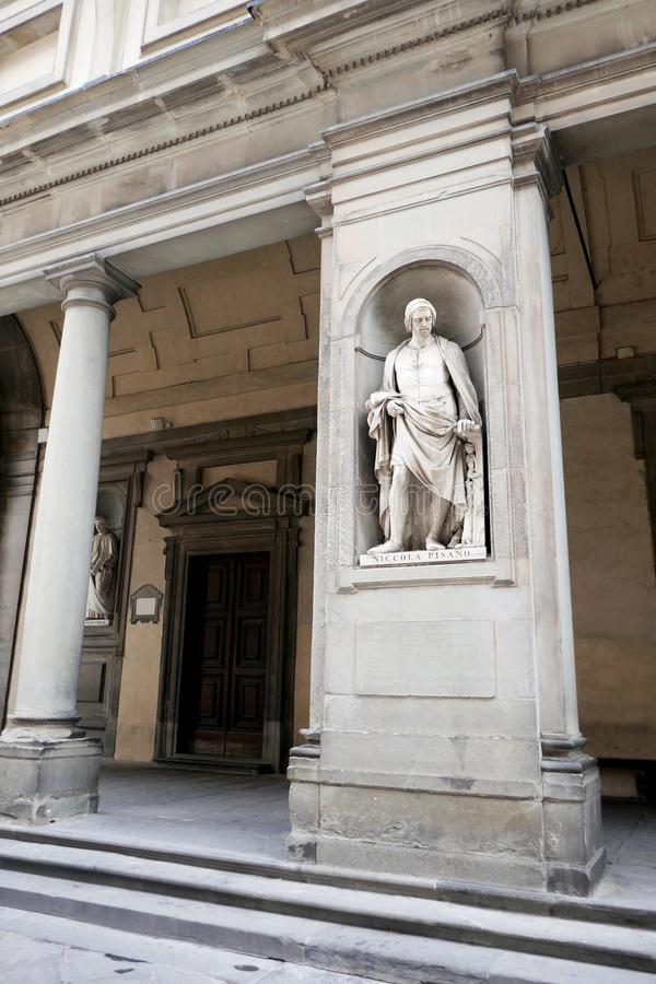 Statue of Niccola Pisano in the niches of the Uffizi Gallery colonnade,. Florence royalty free stock image