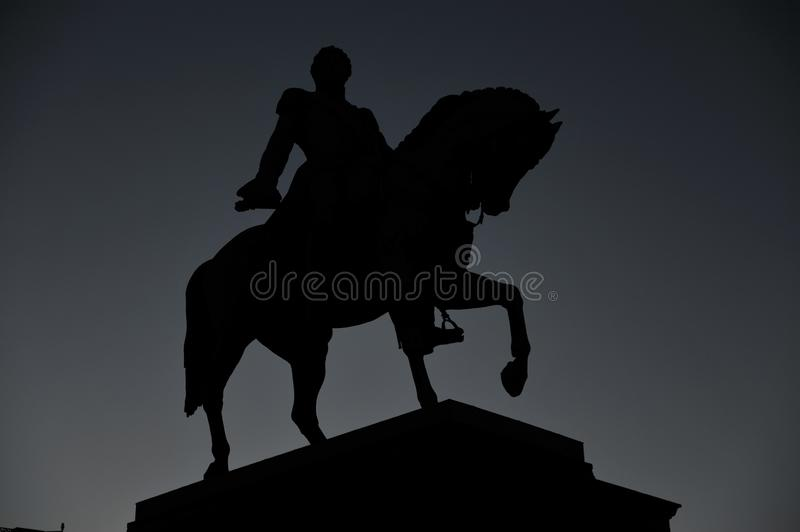 Statue of Norwegian King Karl Johan XIV in silhouette royalty free stock photography