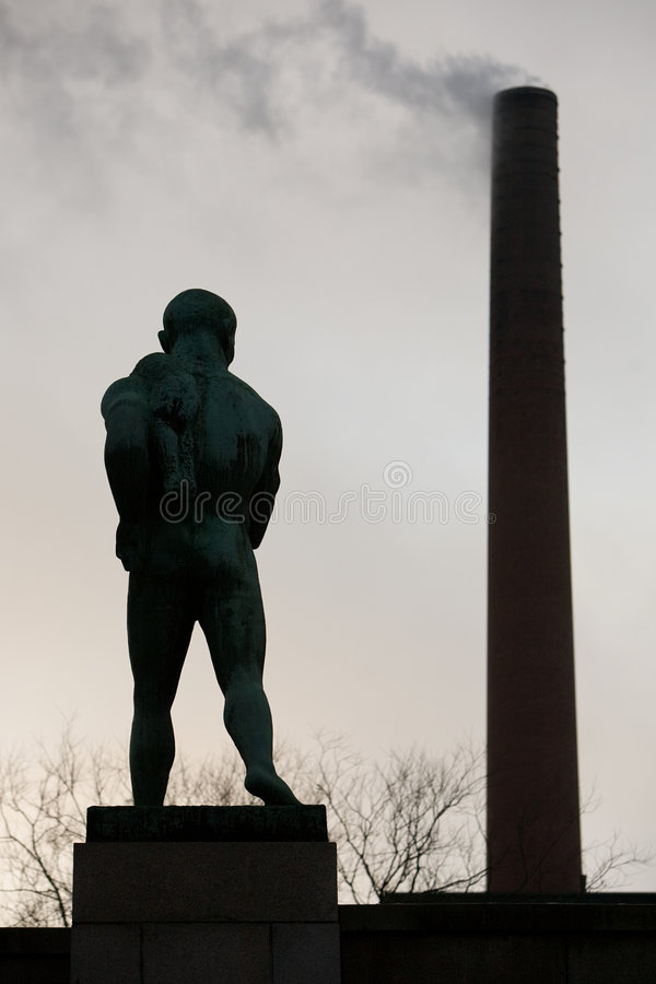 Statue of nude man from back. Statue of nude man against industry pipes from back stock photos