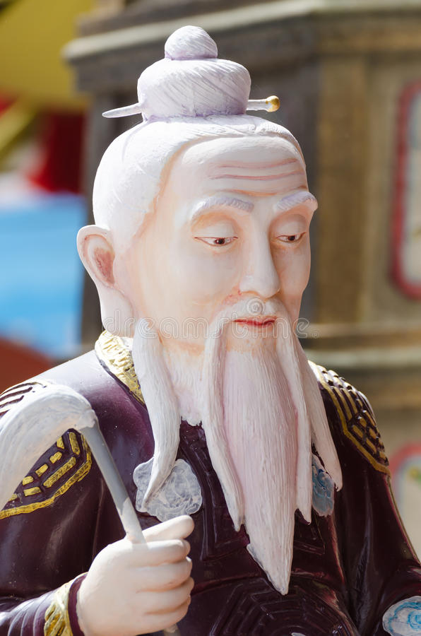 Statue of old Chinese man. stock images