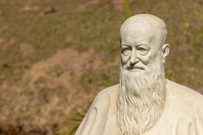 A statue of a old priest royalty free stock photography