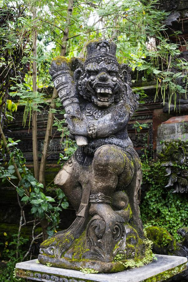 Statue of old stone cruel monkey Hindu temple, Ubud, Bali. Statue of old stone cruel monkey with weapon in traditional Hindu temple in Ubud, Bali, .Indonesia stock images