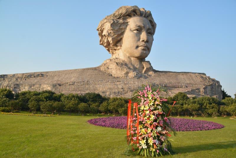 Statue orange de Mao Zedong de la jeunesse d'île de Tchang-cha photographie stock libre de droits