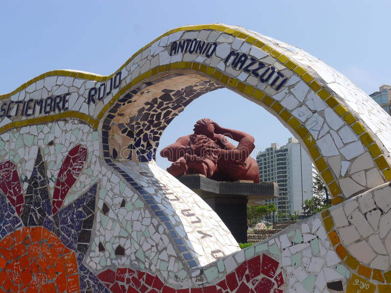 Statue and ornate tiled bench in Miraflores, Lima. Scenical view of an ornate tiled bench and the love statue called The Kiss in the Love Park (El Parque del stock photo