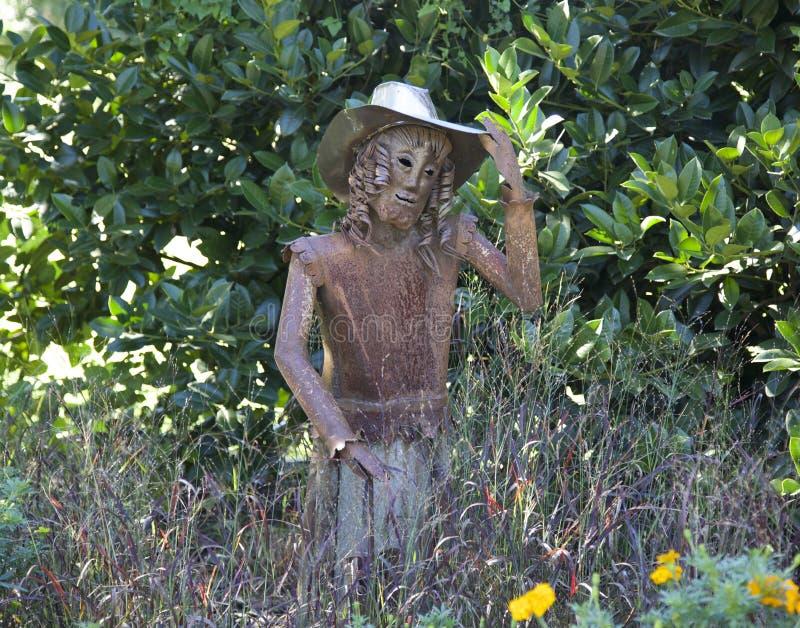 Statue ornementale de fille dans le chapeau de cowboy photographie stock libre de droits