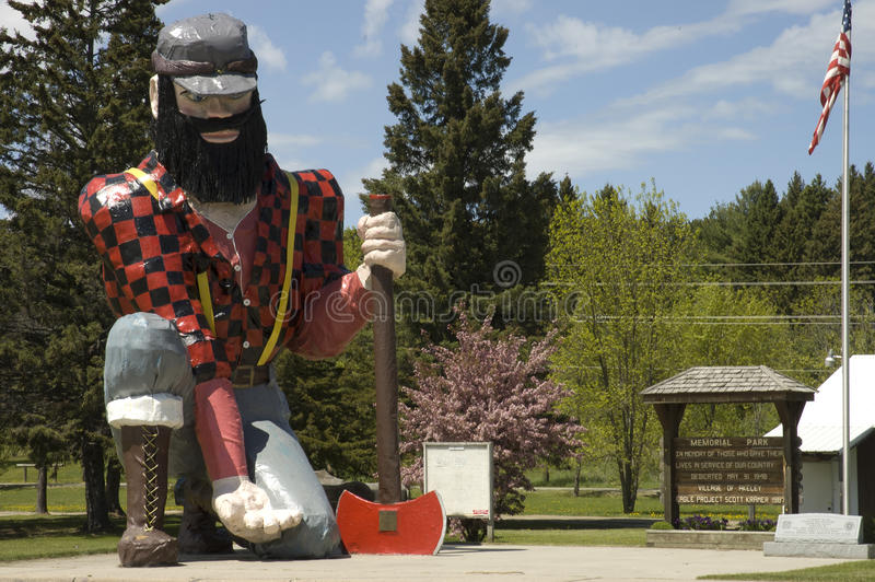 Statue of Paul Bunyan the giant lumberjack. Close view of the statue of Paul Bunyan the giant lumberjack, mythical hero of the lumber camps, in memorial park on stock photography