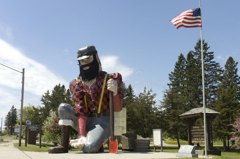 Statue of Paul Bunyan the giant lumberjack. Side view of the statue of Paul Bunyan the giant lumberjack, mythical hero of the lumber camps, in memorial park on royalty free stock images
