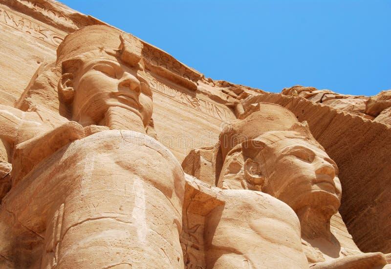 Abu Simbel staues. Statue of a pharaon fron the ancient Egypt touring Abu Simbel royalty free stock images