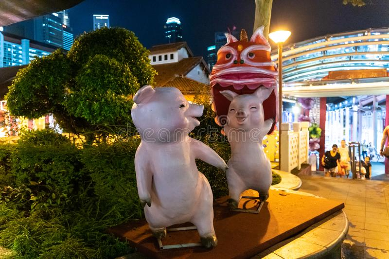 Statue of the pigs - symbol of the next coming Lunar New Year placed at Chinatown in Singapore royalty free stock images