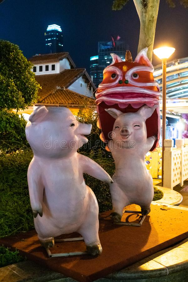 Statue of the pigs - symbol of the next coming Lunar New Year placed at Chinatown in Singapore royalty free stock photos