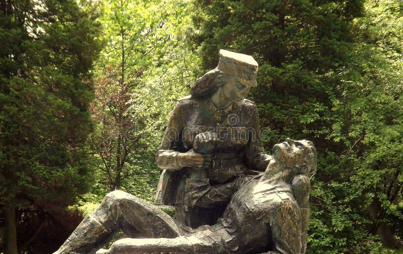 STATUE OF POLISH ARMY PARAMEDIC. POMNIK SANITARIUSZKI. Great statue of Polish army paramedic during World War II in Kołobrzeg royalty free stock photo