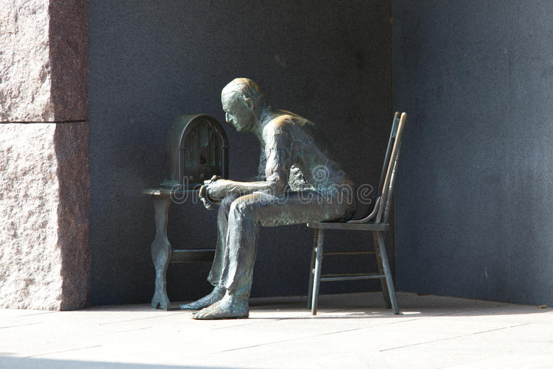 Statue Of Poor Man Listening To Radio Stock Image