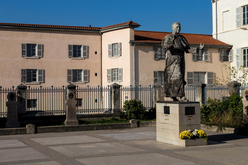 Statue of a Pope in a court yard. With flowers royalty free stock image