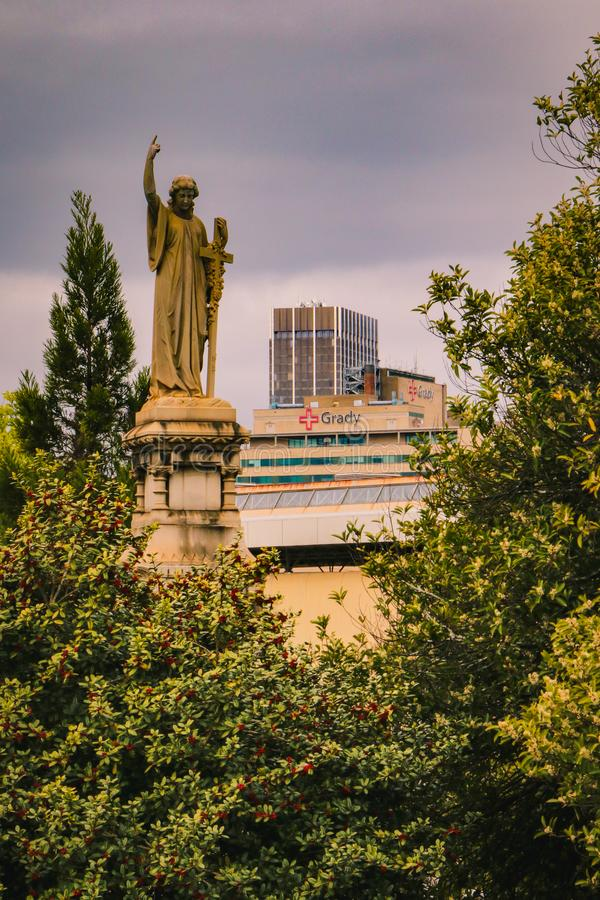 Statue praying over a hospital royalty free stock photo