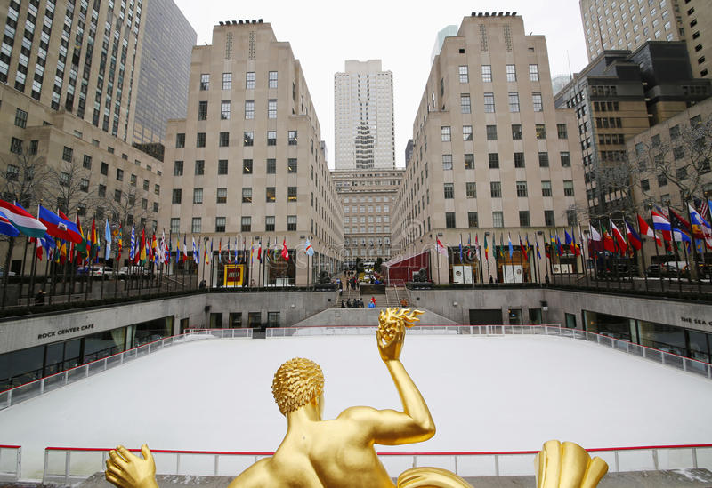 Statue of Prometheus and ice-skating rink at the Lower Plaza of Rockefeller Center stock images