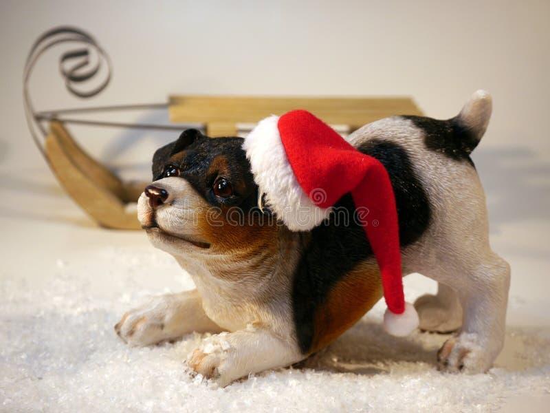 Statue of puppy in stocking cap stock photos