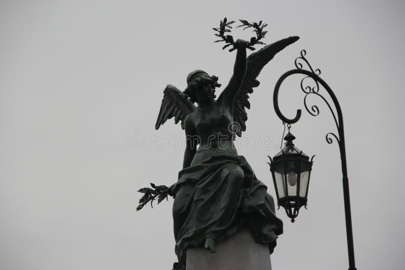 Statue raising crown, Recoleta Cemetery. Caba stock photo