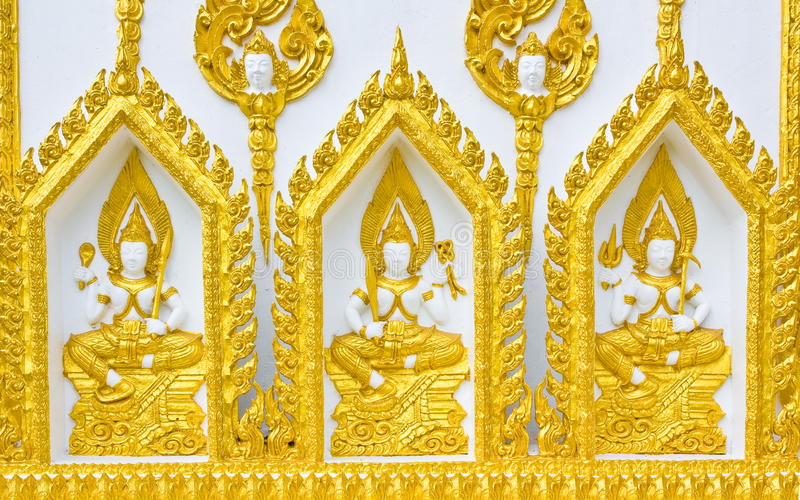 Statue About Religion On The Wall, Thai Temple Stock Images