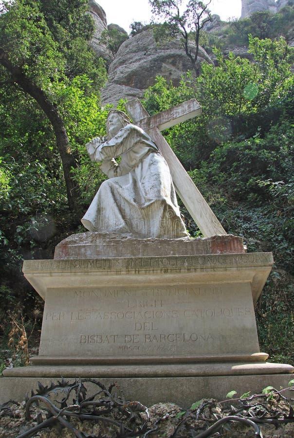 Statue The Road to Calvary carrying the cross at the Benedictine abbey Santa Maria de Montserrat, Spain stock photos