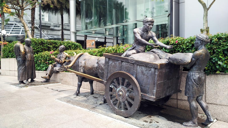 Statue at the roadside in Singapore stock photo