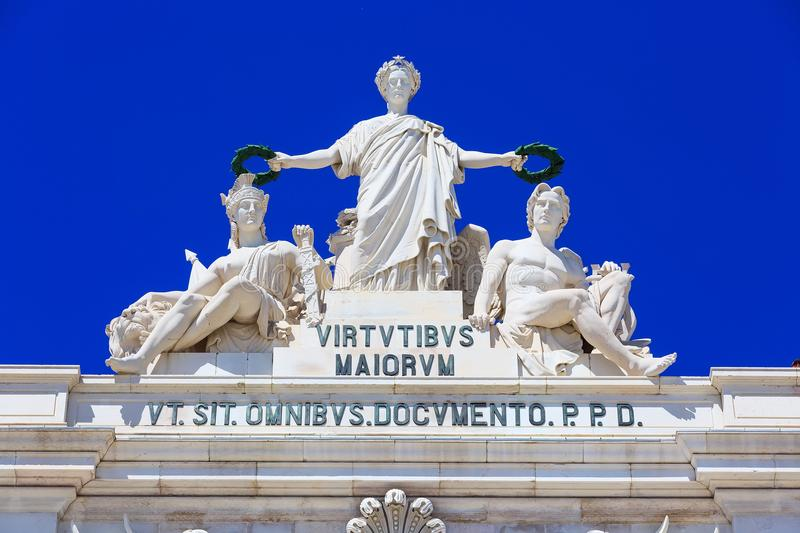 Statue at Rua Augusta Arch at Commerce square in Lisbon, Portugal royalty free stock photography