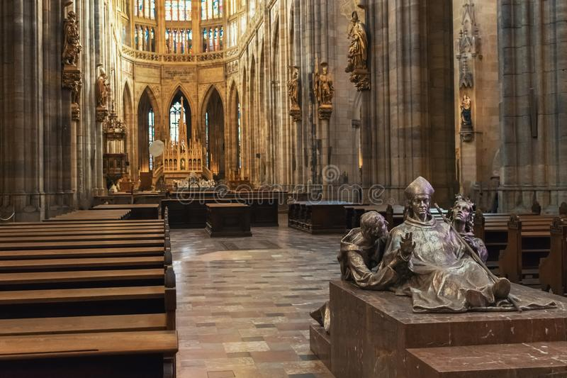 Statue of ruler and his servants inside St. Vitus Cathedral without people with benches. Statue of a ruler and his servants inside St. Vitus Cathedral without stock photography