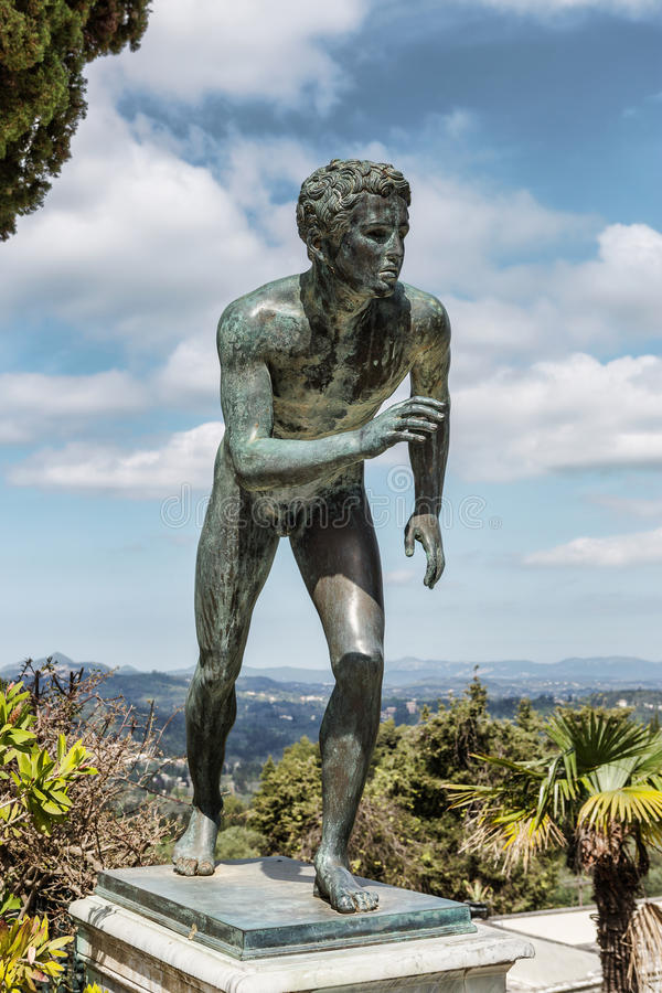 A statue of 'The Runner' in the garden of Achilleion royalty free stock images