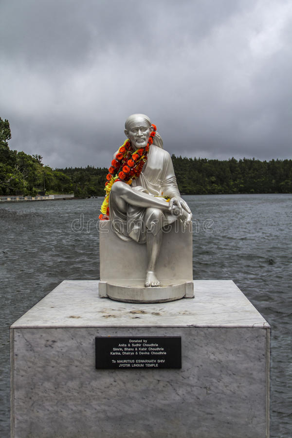 Statue of Sai Baba. With sacred lake in background royalty free stock photos