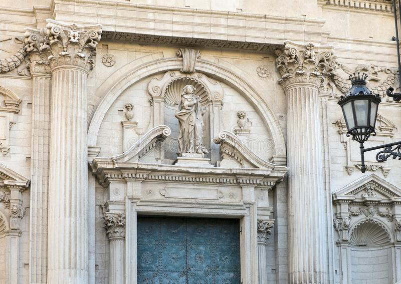 Statue of Saint above the entrance of the Church of Saint Irene, Lecce Italy. Pictured is a statue of Saint Irene above the entrance to the Church of Saint Irene stock image