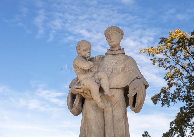 Statue of Saint Anthony of Padua with Baby Jesus in his arms in Cesky Krumlov, Czech Republic. Pictured is a Statue of Saint Anthony of Padua with Baby Jesus in stock image