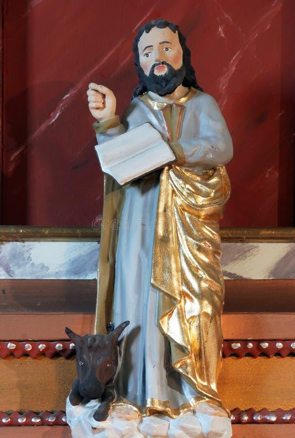 Saint Luke the Evangelist. Statue of Saint Luke the Evangelist on the pulpit in Saints Cosmas and Damian church in Vrhovac, Croatia stock photo