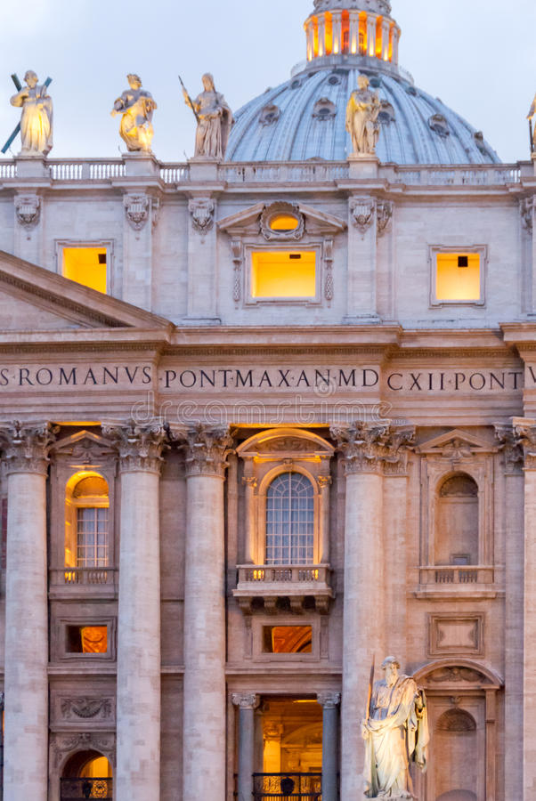Statue of Saint Paul the Apostle in front of the facade of St. Peter`s Basilica II. stock images