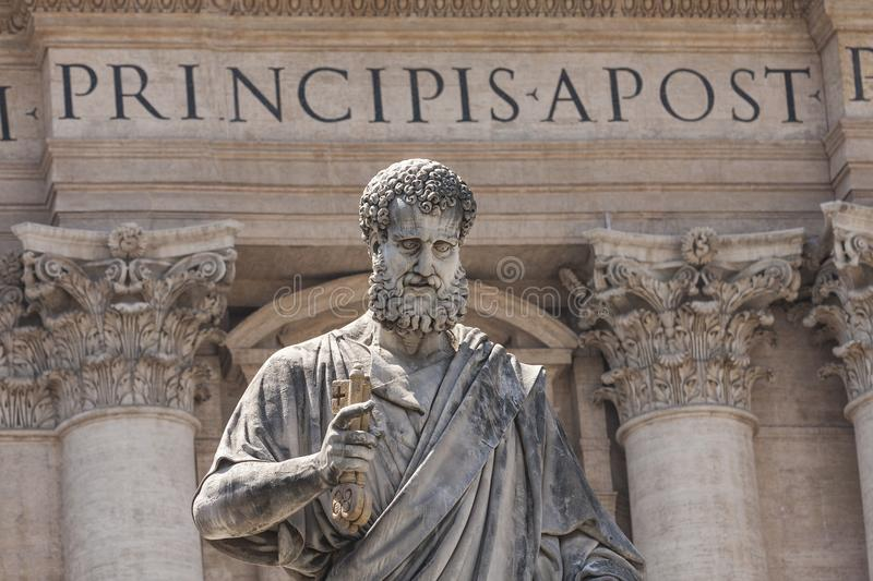 Statue of Saint Peter holding the keys of the Christian church in Saint Peter`s Square Vatican City royalty free stock image