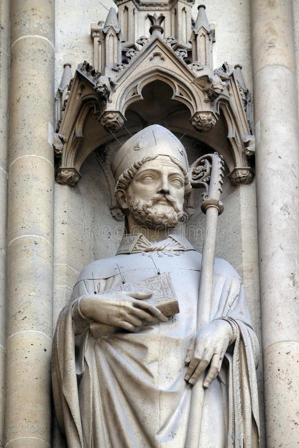 Statue of Saint on the portal of the Basilica of Saint Clotilde in Paris, France royalty free stock photo