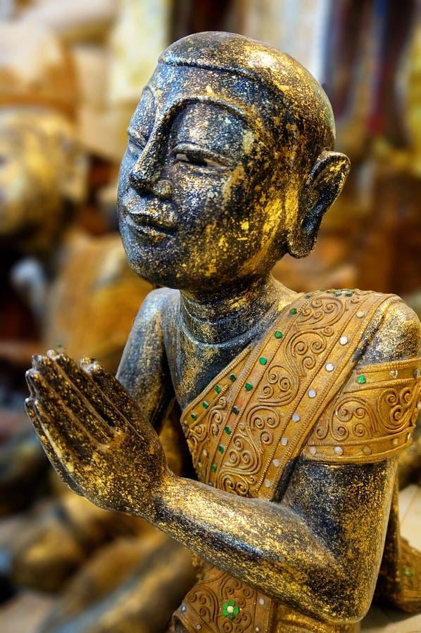 Statue of a seated Buddhist monk. Wat Laem Suvannaram temple royalty free stock photos