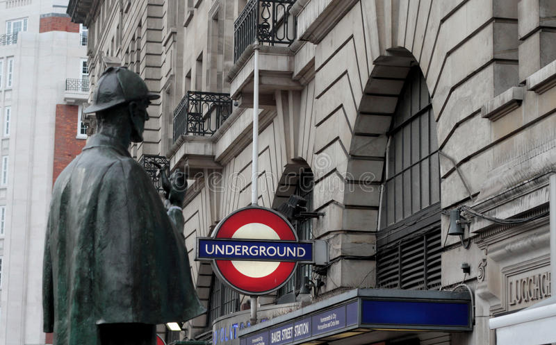 Statue of Sherlock Holmes, London. Statue of Sherlock Holmes in London with Underground sign in background stock image