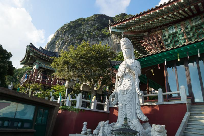 Statue at Sanbanggulsa temple in front of Sanbang mountain, Sanbang-ro, Jeju Island, South Korea royalty free stock photo