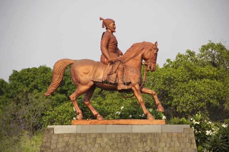 Statue Shivaji Maharaj riding on horse at Pune University campus, Pune, India royalty free stock images