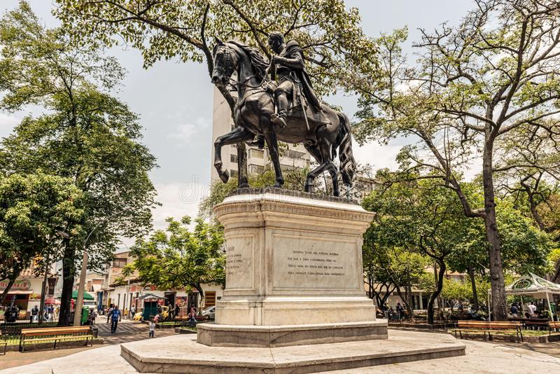 Statue of Simon Bolivar on the horse located at Bolivar Park in. Medellin, Colombia - March 26, 2018: Statue of Simon Bolivar on the horse located at Bolivar stock photos