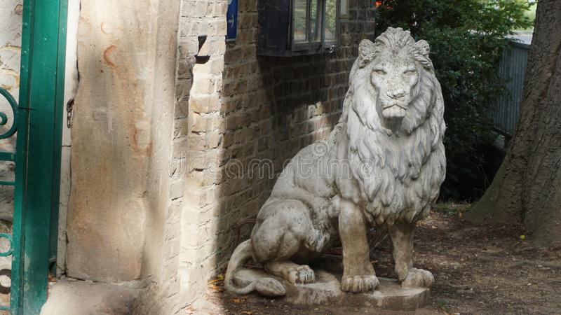 Statue of sitting lion at entrance Gate of Castle Satzvey stock images