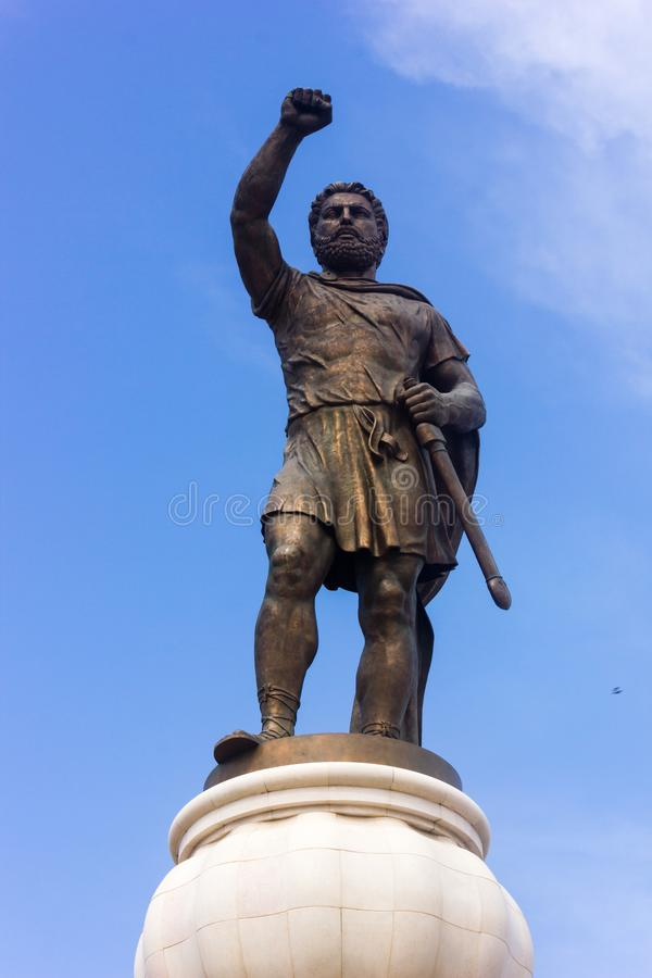 Statue in Skopje, Republic of Macedonia. Statue in Skopje with clenched fist and sword, Republic of Macedonia, blue sky stock photos