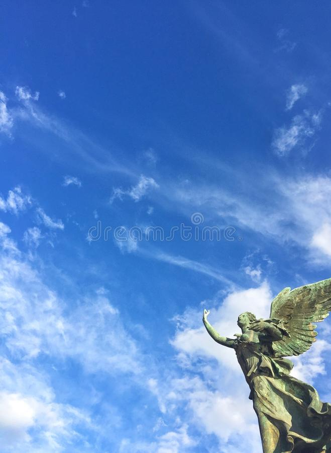 Statue in the sky stock image